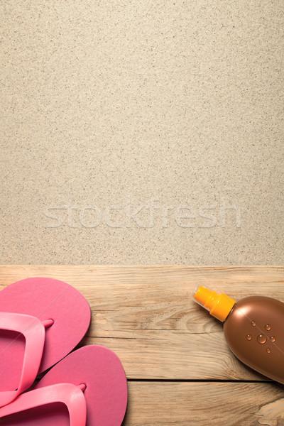 Zomer roze zonnebrand olie zandstrand Stockfoto © Bozena_Fulawka