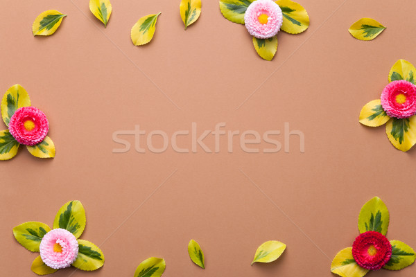 Daisies with Leaves on Brown Background  Stock photo © Bozena_Fulawka