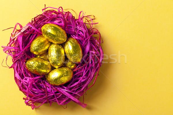 Húsvéti tojások csokoládé rózsaszín fészek ünnep citromsárga Stock fotó © Bozena_Fulawka