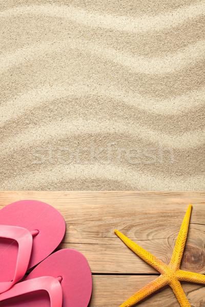 Nyár rózsaszín papucs citromsárga tengeri csillag homokos tengerpart Stock fotó © Bozena_Fulawka