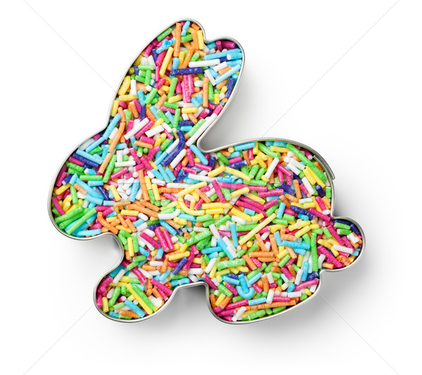 Stock photo: Colorful Candy Sprinkles in Cookie Cutter in Shape of Bunny