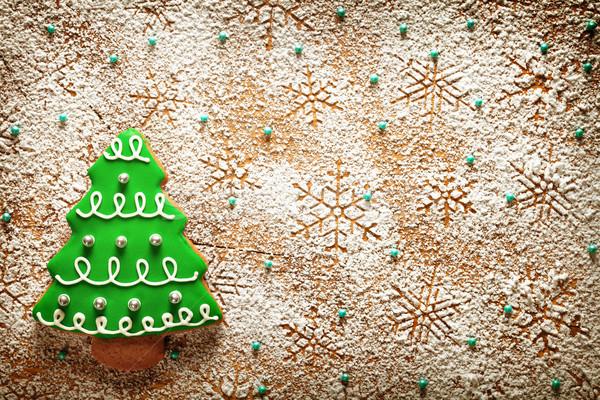 Natal pão de especiarias árvore flocos de neve açúcar de confeiteiro mesa de madeira Foto stock © Bozena_Fulawka