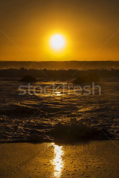日没 太陽 小 波 ビーチ 空 ストックフォト © bradleyvdw