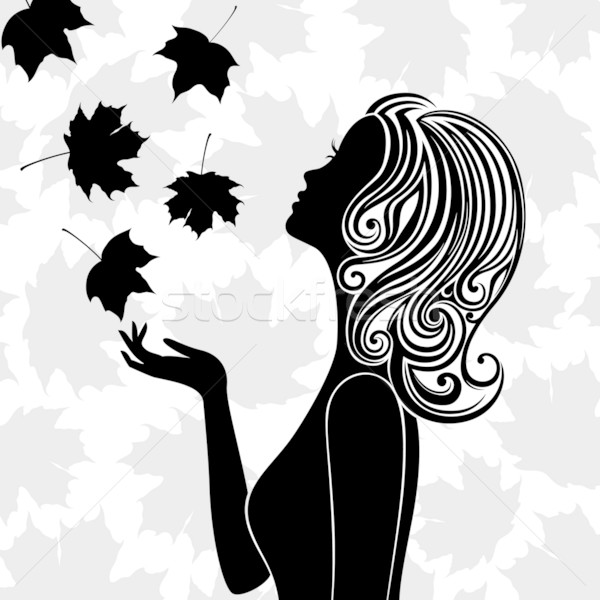 Silhouette of young woman with flying leaves Stock photo © brahmapootra