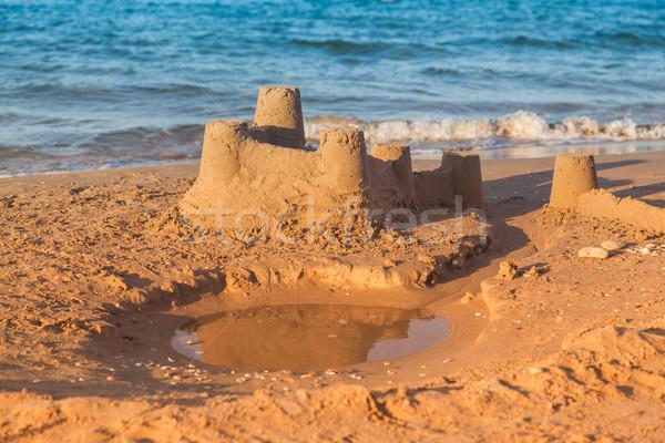 Sandcastle - concept of making save building Stock photo © brebca