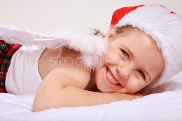 Christmas anioł dziewczynka Święty mikołaj hat Zdjęcia stock © brebca