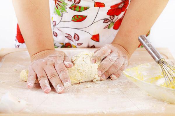 Woman kneading dough Stock photo © brebca