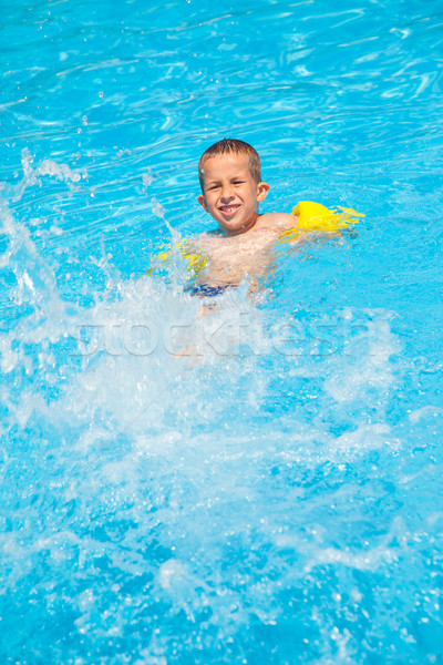 Happy boy with water rings have a fun Stock photo © brebca