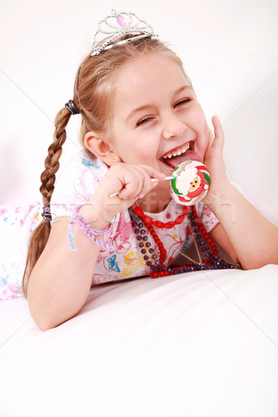Lovely princess with lollipop Stock photo © brebca