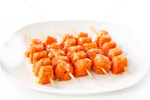 Nyers marinált tyúk fehér tányér vacsora Stock fotó © brebca