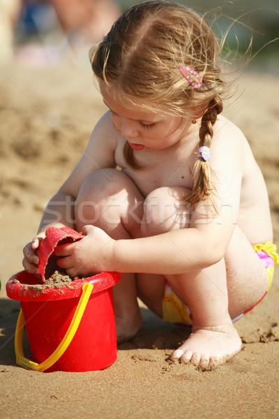 Girl playing on the beach Stock photo © brebca