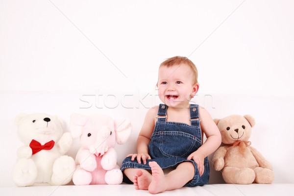 Lovely baby girl with toys Stock photo © brebca