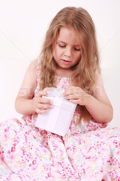 Little girl opening present Stock photo © brebca