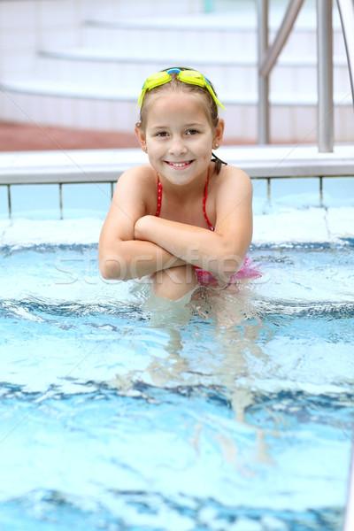Gyermek megnyugtató úszómedence aranyos védőszemüveg mosoly Stock fotó © brebca
