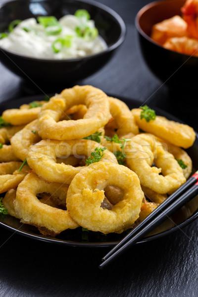 Fried calamari rings Stock photo © brebca