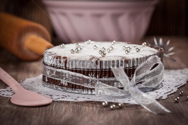 White and chocolate Christmas cake with baking utensils Stock photo © brebca