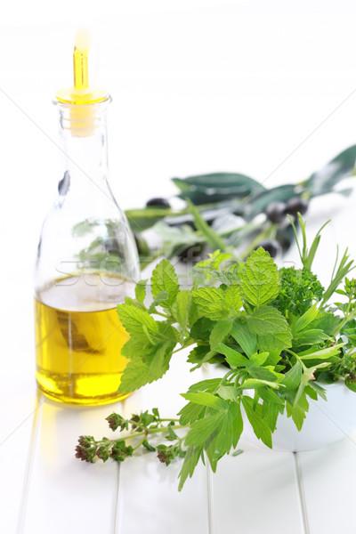 Herbes huile d'olive fraîches jardin lumière laisse Photo stock © brebca