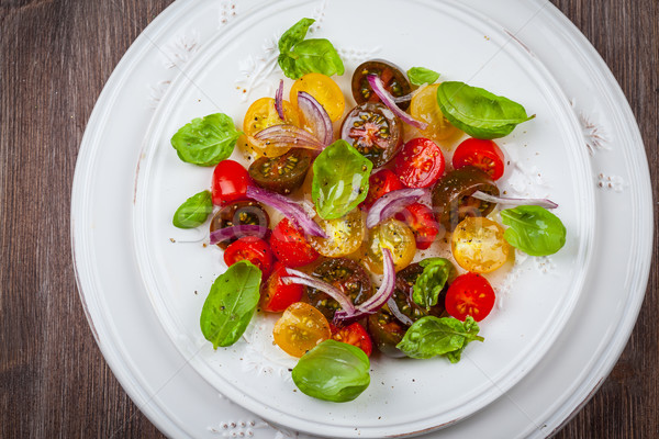 Tomato salad with onions and basil Stock photo © brebca