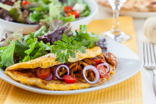 Omelet filled with chanterelle mushrooms Stock photo © brebca