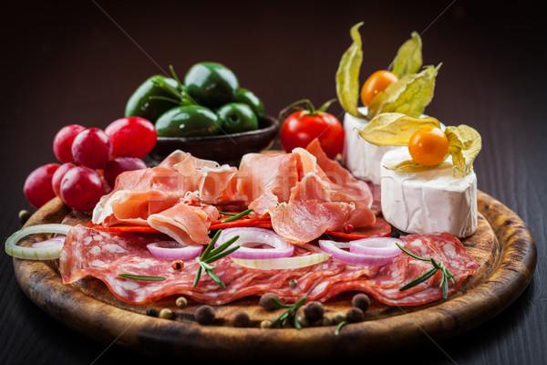Vacsora vendéglátás különböző előételek étel bor Stock fotó © brebca