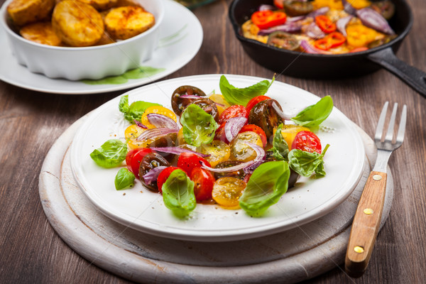 Tomato salad with grilled cheese and baked potatoes Stock photo © brebca