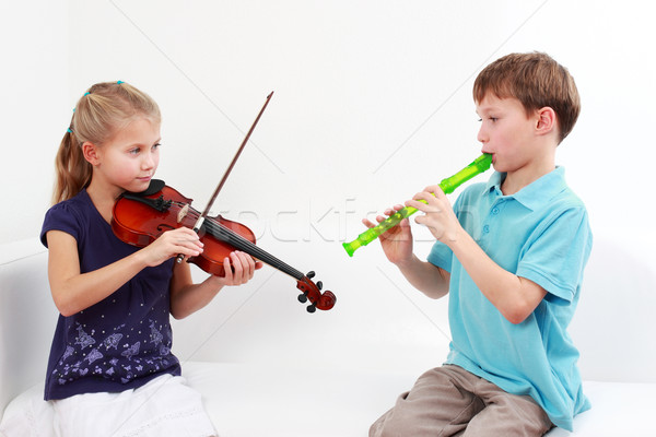 Kids playing flute and violin Stock photo © brebca
