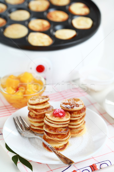 Sweet pancakes with pancake maker Stock photo © brebca