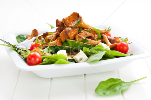 Fresh baby spinach with roasted chanterelle mushrooms Stock photo © brebca