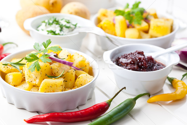 Baked potatoes with chutney and sour cream Stock photo © brebca