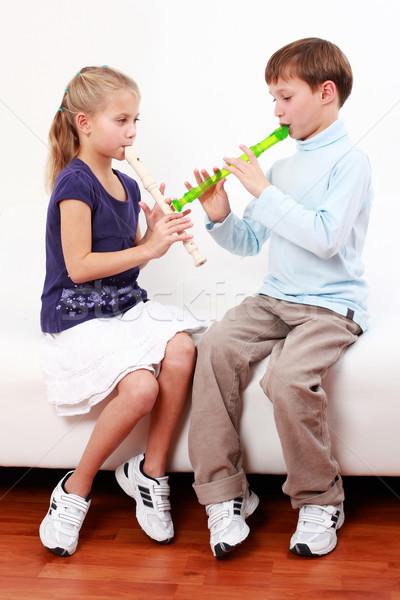 Kids playing flute Stock photo © brebca