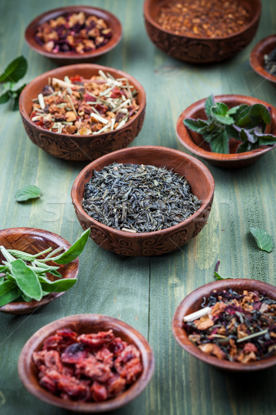 Assortiment sécher thé bols bois fruits Photo stock © brebca
