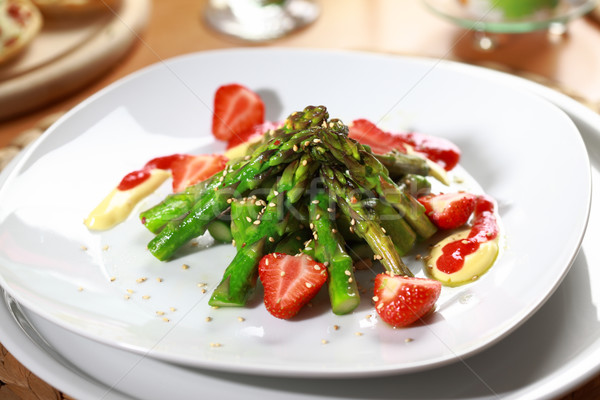 Caramelized asparagus with strawberry Stock photo © brebca