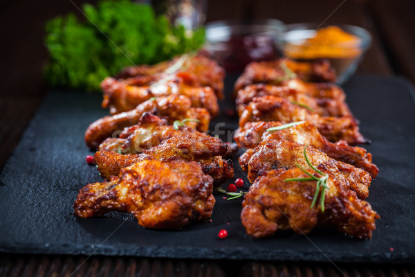 Chicken wings with spices and herbs Stock photo © brebca