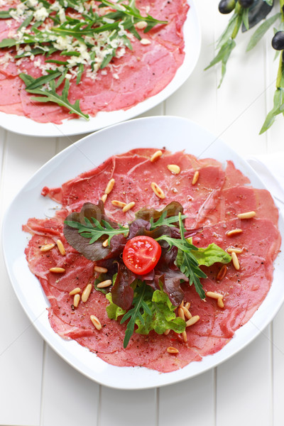 Carpaccio with salad and pine nut Stock photo © brebca
