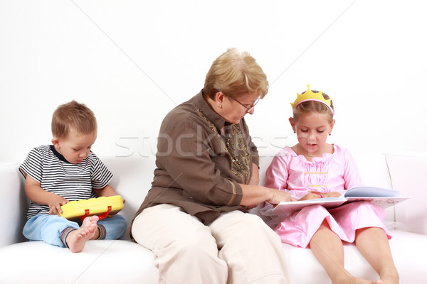 Reading and playing with granny Stock photo © brebca