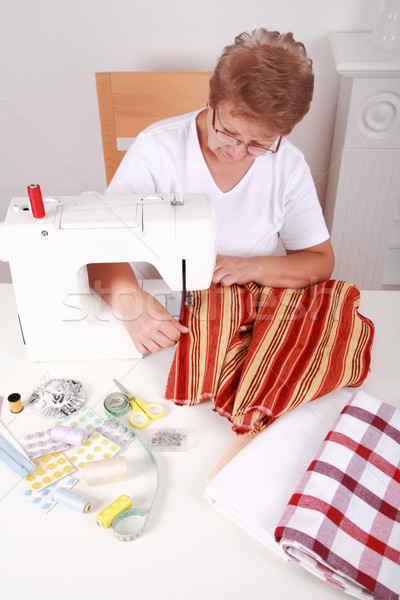 Elderly woman sewing Stock photo © brebca