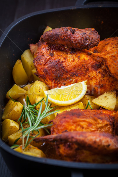 Baked pork meat with potatoes Stock photo © brebca