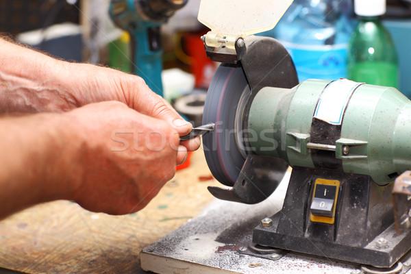 Man working with sharpening machine tool Stock photo © brebca