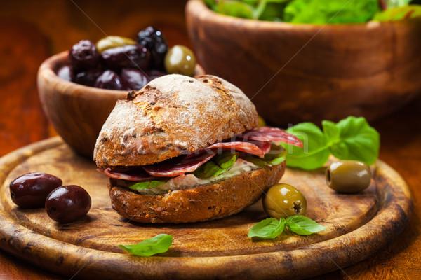 сэндвич итальянский салями Сыр из козьего молока свежие оливками Сток-фото © brebca