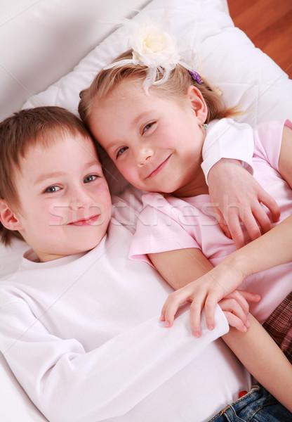 Ninos cama cute junto familia sonrisa Foto stock © brebca