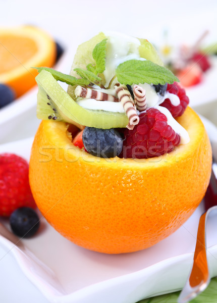Orange filled with fruits Stock photo © brebca
