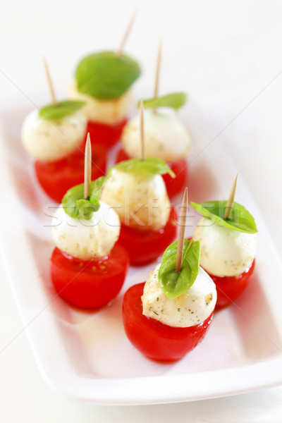 Voorgerechten gemarineerd mozzarella snack tomaten blad Stockfoto © brebca