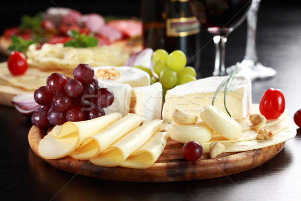 Cheese and salami platter with herbs Stock photo © brebca