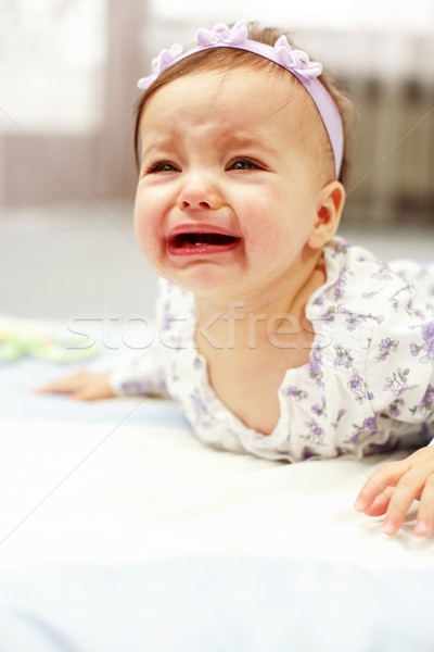 Portrait of crying baby girl Stock photo © brebca