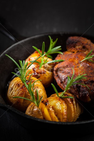 Pulled pork dish with backed rustic potates Stock photo © brebca