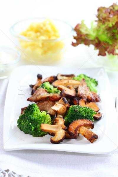 Stock photo: Roasted pork meat with shiitake mushrooms
