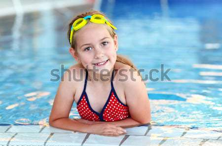 Cute girl with goggles in swimming pool Stock photo © brebca