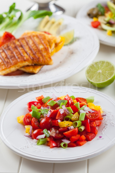 Salsa salad with grilled cheese Stock photo © brebca