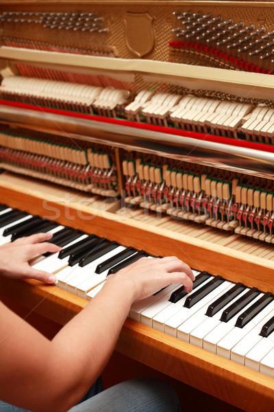 Hands playing piano Stock photo © brebca