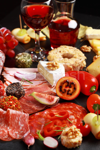 Antipasto catering platter with red wine Stock photo © brebca